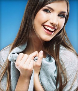Woman from Encinitas shows off her straight teeth thanks to Invisalign clear braces treatment in Carlsbad.